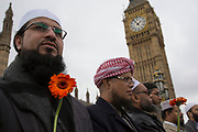 Thousands of people including police officers and Muslim faith leaders gathered on Westminster Bridge to hold a vigil and a minutes silence one week after the terror attack, on March 29th 2017 in London, United Kingdom. Imams from local communities stand together in solidarity and voicing their opposition to the attacks in front of the Houses of Parliament.