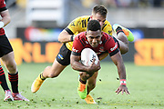 Crusaders Sevu Reece is tackled by Hurricanes Wes Goosen in the Super Rugby match, Hurricanes v Crusaders, Sky Stadium, Wellington, Sunday, April 11, 2021. Copyright photo: Kerry Marshall / www.photosport.nz