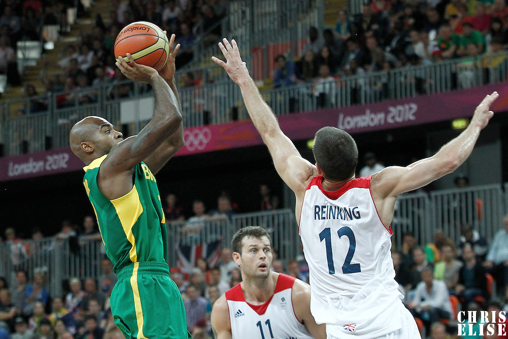31 July 2012: Brazil Larry Taylor takes a jumpshot Great Britain Nate Reinking during 67-62 Team Brazil victory over Team Great Britain, during the men's basketball preliminary, at the Basketball Arena, in London, Great Britain.