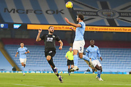 Manchester City defender Rúben Dias (3) heads clear under pressure from Burnley forward Jay Rodriguez (19) during the Premier League match between Manchester City and Burnley at the Etihad Stadium, Manchester, England on 28 November 2020.