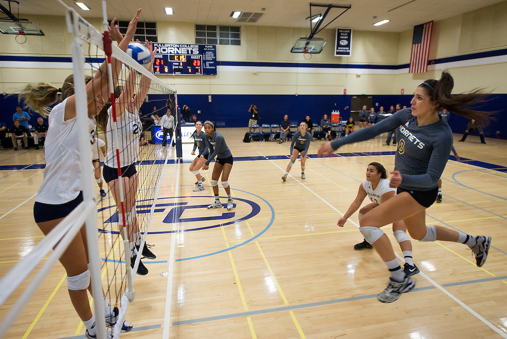 Irvine Valley College's #33 Hannah Matt and #20 Kayla Shields attempt a block against Fullerton College's #8 outside hitter Grace Lopez at the Fullerton vs. Irvine Valley women's volleyball game held at Fullerton College on Friday, Nov. 6, 2015 in Fullerton, Calif. The Fullerton Hornets won the match after 5 games.