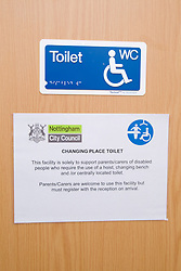 Notice on door of wheelchair accessible WC that doubles up as a changing room,