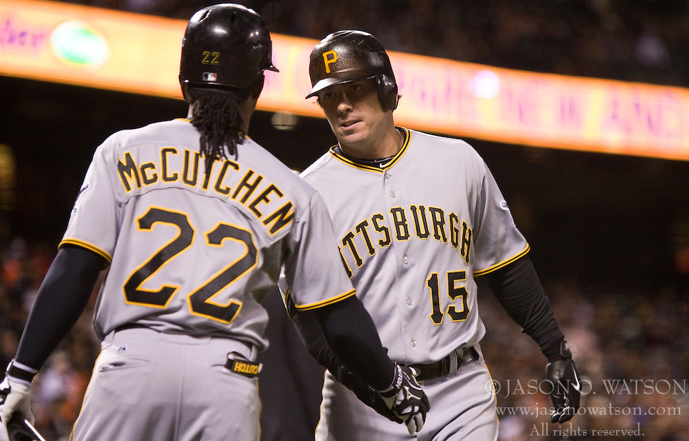 April 12, 2010; San Francisco, CA, USA;  Pittsburgh Pirates third baseman Andy LaRoche (15) is congratulated by center fielder Andrew McCutchen (22) after scoring a run against the San Francisco Giants during the seventh inning at AT&T Park. San Francisco defeated Pittsburgh 9-3.