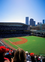 Stock photo of the view of a Houston Astros baseball game from the upper stands showing the Houston skyline