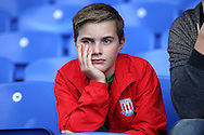 a Young Stoke City fan looks on from his seat before k/o.  Premier League match, Crystal Palace v Stoke city at Selhurst Park in London on Sunday 18th Sept 2016. pic by John Patrick Fletcher, Andrew Orchard sports photography.