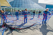 Drill, Spill, Kill - the message on a net trapping protestors like fish. Environmental protestors outside the BP AGM at the Excel Centre. They are highlighting the dangers of deep sea drilling and the damage to the Gulf. As well as being anti tar sands oil and the general impact of burning fossil fuels on the environment.