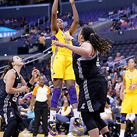 25 May 2014: Los Angeles Sparks forward Nneka Ogwumike (30) takes a jumpshot over San Antonio Stars forward/center Danielle Adams (23) during the Los Angeles Sparks 83-62 victory over the San Antonio Stars, at the Staples Center, Los Angeles, California, USA.