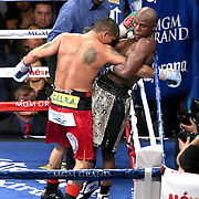 LAS VEGAS, NV - SEPTEMBER 13: Floyd Mayweather Jr. (R) holds the arm of Marcos Maidana during their WBC/WBA welterweight title fight at the MGM Grand Garden Arena on September 13, 2014 in Las Vegas, Nevada. (Photo by Alex Menendez/Getty Images) *** Local Caption *** Floyd Mayweather Jr; Marcos Maidana