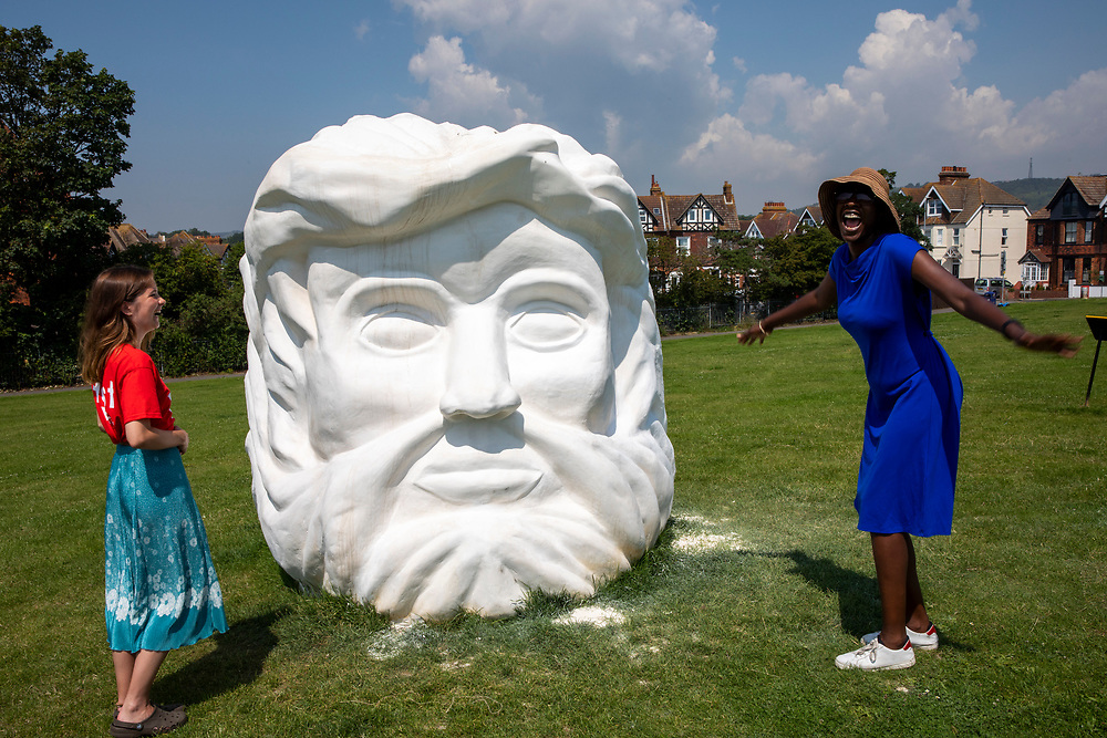 Janus' Fortress: Folkestone by Pilar Quinteros is a monumental sculptural head with two faces, representing Janus, the Roman god of beginnings and transitions,who was often associated with thresholds – and so also with a present poised between the past and the future on 20th of July 2021, in Folkestone, United Kingdom. The sculpture is located high up on the East Cliff, overlooking Folkestone's harbour, and with its two faces is able to look both towards the European mainland and towards England, connecting them, as Folkestone hasalways done whether as a fortress or a port. It is made of chalkand plaster, and will gradually erode and disintegrate. The artist's intention was to make a kind of anti-monument, imposing in scale but ephemeral and vulnerable. Its disintegration also mirrors (and reflects on) the gradual erosion of the chalk cliffs and coastline. The white cliffs of Dover are sometimes referred to as the fortress walls of England. The artwork is part of the Creative Folkestone Triennial 2020, The Plot, which sees 27 newly commissioned artworks appearing around the south coast seaside town. The new work builds on the work from previous triennials making Folkestone the biggest urban outdoor contemporary art exhibition in the UK. (photo by Andrew Aitchison / In pictures via Getty Images)
