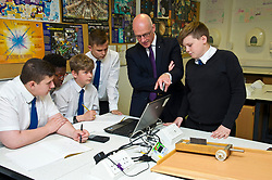 Pictured: John Swinney was very interested in the physics class experiments<br /> <br /> Deputy First Minister and Education Secretary John Swinney visited St Augiustine's RC High School in Edinburgh to speak to young people about attainment and leaving schools with the suite of statistics published today. St Augustine's RC High School<br /> <br /> <br /> Ger Harley | EEm 19 June 2018