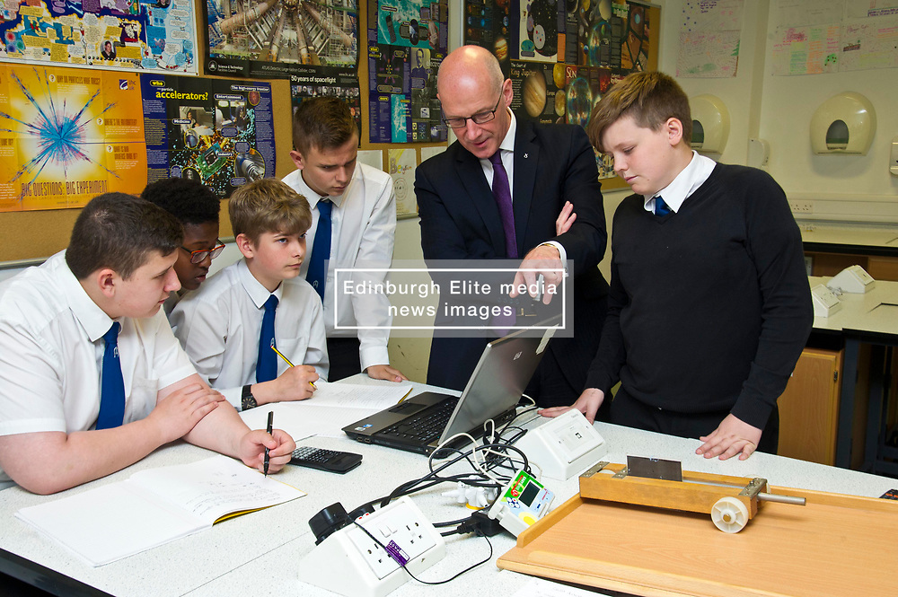 Pictured: John Swinney was very interested in the physics class experiments<br /> <br /> Deputy First Minister and Education Secretary John Swinney visited St Augiustine's RC High School in Edinburgh to speak to young people about attainment and leaving schools with the suite of statistics published today. St Augustine's RC High School<br /> <br /> <br /> Ger Harley   EEm 19 June 2018
