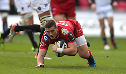 Scarlets' Scott Williams runs in to score the first try of the game during the European Champions Cup, pool three mach at Parc y Scarlets, Llanelli.