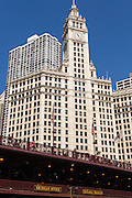Wrigley Building with the DuSable Bridge viewed from Riverwalk on a summers day in Chicago, Illinois, USA