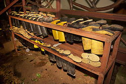 Boots In Storage On Racks For The Night, Tiputini
