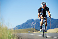 AJ Johnson of Erie rides US Hwy 36 on the north side of Boulder, CO. © Brett Wilhelm