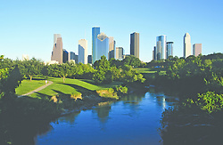 The Houston skyline with Buffalo Bayou in the foreground.
