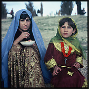 Mother and daughter snack on Nowruz, the Persian New Year, on the hill of Kabul.
