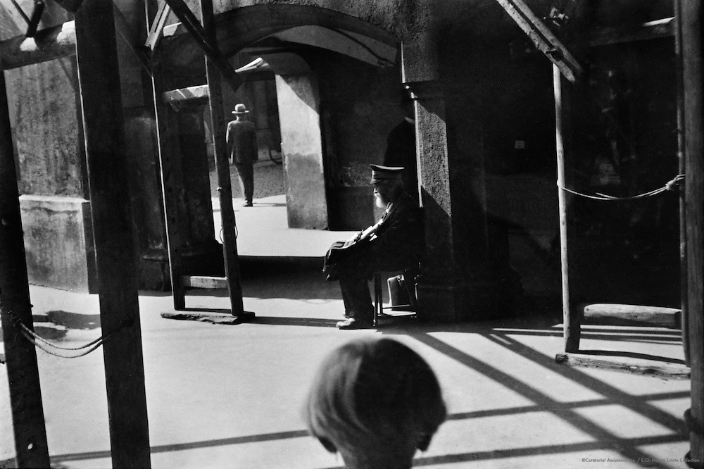 Seated Man with Man in Doorway, Munich, 1931