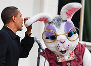 U.S. President Barack Obama jokingly speaks into the ear of the Easter Bunny after his microphone failed during the annual Easter Egg Roll on the South Lawn at the White House in Washington, April 13, 2009.   REUTERS/Jim Young