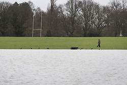 © Licensed to London News Pictures. 02/04/2018. London, UK. People walk next to rising floodwater at Deer Park near Richmond Lock.  Heavy rain has caused some flooding in areas near the River Thames in the south. Photo credit: Peter Macdiarmid/LNP