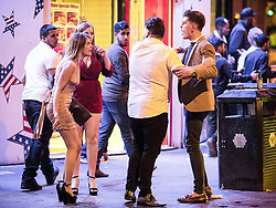 © Licensed to London News Pictures . 01/01/2016 . Manchester , UK . A man and a woman argue . Revellers in Manchester on a New Year night out at the clubs around the city centre's Printworks venue . Photo credit : Joel Goodman/LNP