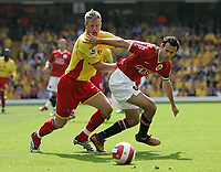 Photo: Lee Earle.<br /> Watford v Manchester United. The Barclays Premiership. 26/08/2006. Watford's Jay DeMerit (L) battles with Ryan Giggs.