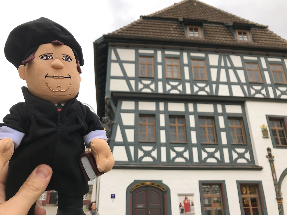 Martin Luther is outside of the Lutherhaus in Eisenach, Germany.