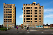 "Empty apartment blocks Woodward Avenue, Detroit. Known as the world's traditional automotive center, ""Detroit"" is a metonym for the American automobile industry and an important source of popular music legacies celebrated by the city's two familiar nicknames, the Motor City and Motown. Many neighborhoods remain distressed since the collapse of the motor industry. The state governor declared a financial emergency in March 2013, appointing an emergency manager. On July 18, 2013, Detroit filed the largest municipal bankruptcy case in U.S. history."