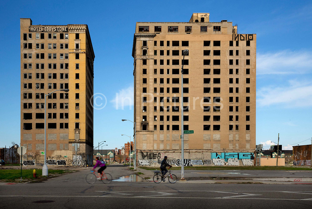 """Empty apartment blocks Woodward Avenue, Detroit. Known as the world's traditional automotive center, """"Detroit"""" is a metonym for the American automobile industry and an important source of popular music legacies celebrated by the city's two familiar nicknames, the Motor City and Motown. Many neighborhoods remain distressed since the collapse of the motor industry. The state governor declared a financial emergency in March 2013, appointing an emergency manager. On July 18, 2013, Detroit filed the largest municipal bankruptcy case in U.S. history."""