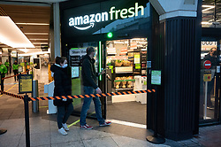 © Licensed to London News Pictures. 04/03/2021. London, UK. Customers enter the first AMAZON GO grocery store in the UK opens in Ealing, West London. Shoppers need to use app to shop inside the store and pick up groceries without stopping to pay. Photo credit: London News Pictures
