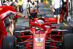 March 25, 2018 - Melbourne, Victoria, Australia - Scuderia Ferrari Managing Director & Team Principal MAURIZIO ARRIVABENE, left, congratulates race winner SEBASTIAN VETTEL Scuderia Ferrari SF71H in the paddock after the 2018 Formula One Australian Grand Prix, at Albert Park. (Credit Image: © Hoch Zwei via ZUMA Wire)