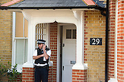 © Licensed to London News Pictures. 23/04/2014. New Malden, UK The scene in New Malden where a woman has been arrested after the discovery of three bodies of children in a house overnight. Photo credit : Stephen Simpson/LNP