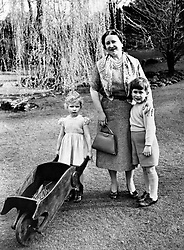 File photo dated 22/04/54 of Princess Anne wheeling her barrow and Prince Charles cuddling up to his grandmother, the Queen Mother in the grounds of the Royal Lodge, Windsor, Berkshire. The picture was taken shortly before they left for Tobruk to join their parents the Queen and the Duke of Edinburgh, homeward bound from the Commonwealth tour.