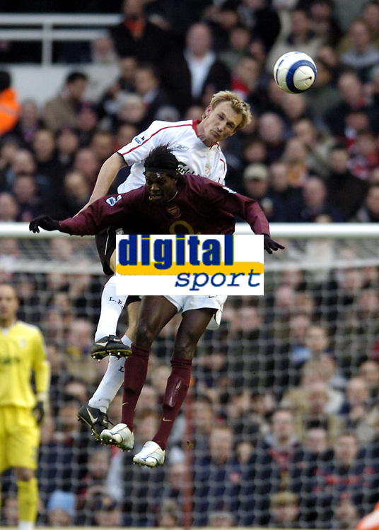 Photo: Olly Greenwood.<br />Arsenal v Liverpool. The Barclays Premiership. 12/03/2006. Arsenals Emmanuel Adebayor and Liverpools Sami Hyypia