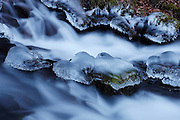 After several days of below-freezing temperatures, ice caps the rocks in Wahkeena Creek, located in Oregon's Columbia River Gorge.