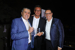 Haim Saban, left, Walter Kolm and David Renzer at Creative Community For Peace 2nd Annual 'Ambassadors Of Peace' Gala held at Los Angeles on September 26, 2019 in Private Residence, California, United States (Photo by © Jc Olivera/VipEventPhotography.com