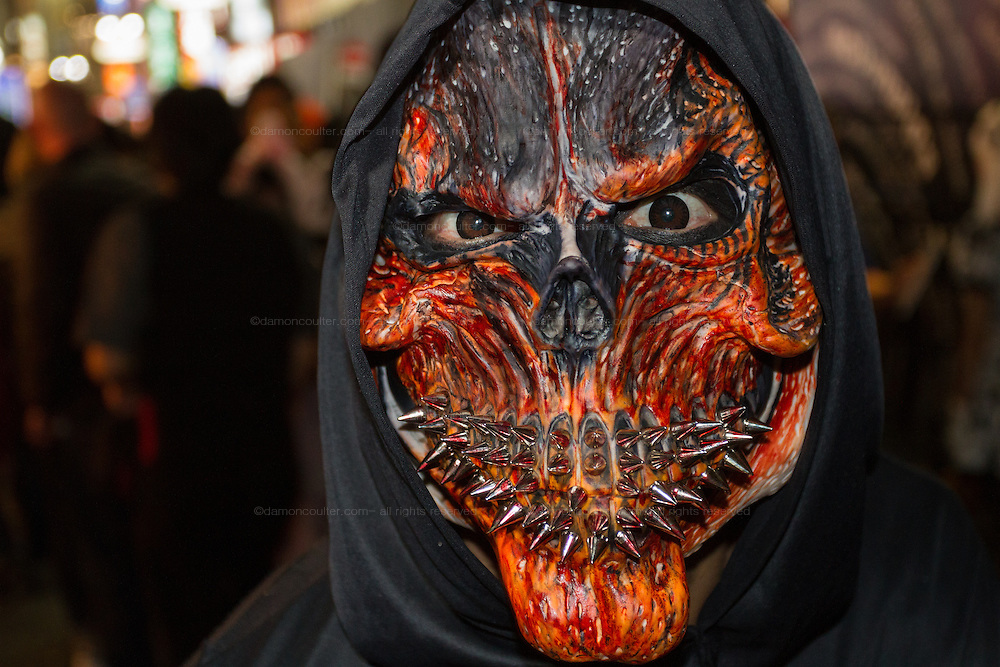 Portrait of a young Japanese reveller in a scary mask during the Halloween celebrations in Shibuya, Tokyo, Japan. Saturday October 29th 2016 Halloween celebration in Japan have grown massively in the last few years. To ensure the safety of the crowds in Shibuya this year, the police closed several roads leading to the famous Hachiko Square, allowing costumed revellers to spread over a larger area.