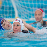 Sun Yating (L) of China and Orsolya Takacs (C) of Hungary fight for the ball during the women waterpolo friendly match of Hungary and China in Tatabanya, Hungary on June 23, 2012. ATTILA VOLGYI