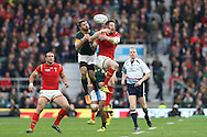 Alex Cuthbert of Wales and Willie Le Roux of South Africa jump  to catch a high ball. Rugby World Cup 2015 quarter final match, South Africa v Wales at Twickenham Stadium in London, England  on Saturday 17th October 2015.<br /> pic by  John Patrick Fletcher, Andrew Orchard sports photography.