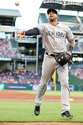 May 22, 2018 - Arlington, TX, U.S. - ARLINGTON, TX - MAY 22: New York Yankees center fielder Aaron Hicks (31) tosses a baseball to the fans during the game between the Texas Rangers and the New York Yankees on May 22, 2018 at Globe Life Park in Arlington, Texas. The Rangers defeat the Yankees 6-4. (Photo by Matthew Pearce/Icon Sportswire) (Credit Image: © Matthew Pearce/Icon SMI via ZUMA Press)
