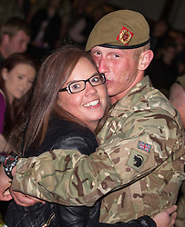 © Licensed to London News Pictures . 25/04/2013. Catterick Barracks , North Yorkshire , UK . Returning soldiers hug and kiss friends and family . Soldiers from the 1st Battalion , the Duke of Lancaster's Regiment (1 Lancs) arrive at Catterick Barracks to be greeted by their families this evening (Thursday 25th April), following a six month tour in Lashkar Gah , Helmand Province , Afghanistan . With the UK combat mission due to complete by the end of 2014 , this is likely to be the last deployment by 1 Lancs in Afghanistan , the British Army reports . Photo credit : Joel Goodman/LNP
