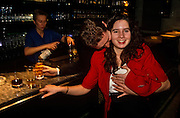 A young girl is groped on the breast by an amorous male acquaintance during a karaoke night in the City of London.