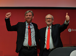 Scottish Labour leader Richard Leonard congratulated by Labour leader Jeremy Corbyn after delivering his keynote speech to the Scottish Labour spring conference 2019 in Dundee.<br /> <br /> © Dave Johnston / EEm
