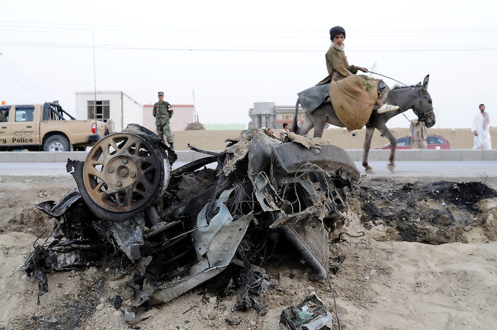 """Pilot, Danielle Aitchison and her partner Chris Hood, narrowly missed being hit by a suicide bomber very similar to the one seen here.  On March 13, 2008 a suicide car bomber rammed into a military convoy on Airport Road, near Kabul International Airport.  The blast killed 6 and injured 15.  Danielle said the blast was 40 meters behind the car she was traveling in and pushed her forward in her seat.  """"We got out of their as quickly as possible, because unfortunately you might go to try and help, but a second one might come and try to kill more people.  That was a very humbling experience that brought you right back to where you were and the dangers of being here."""". .Pictured here:.A suicide bomber rammed his car into a NATO convoy on Monday, August 11th, 2008, in Kabul, Afghanistan.  According to reports a British soldier and 3 Afghan citizens were killed with at least a dozen more injured."""