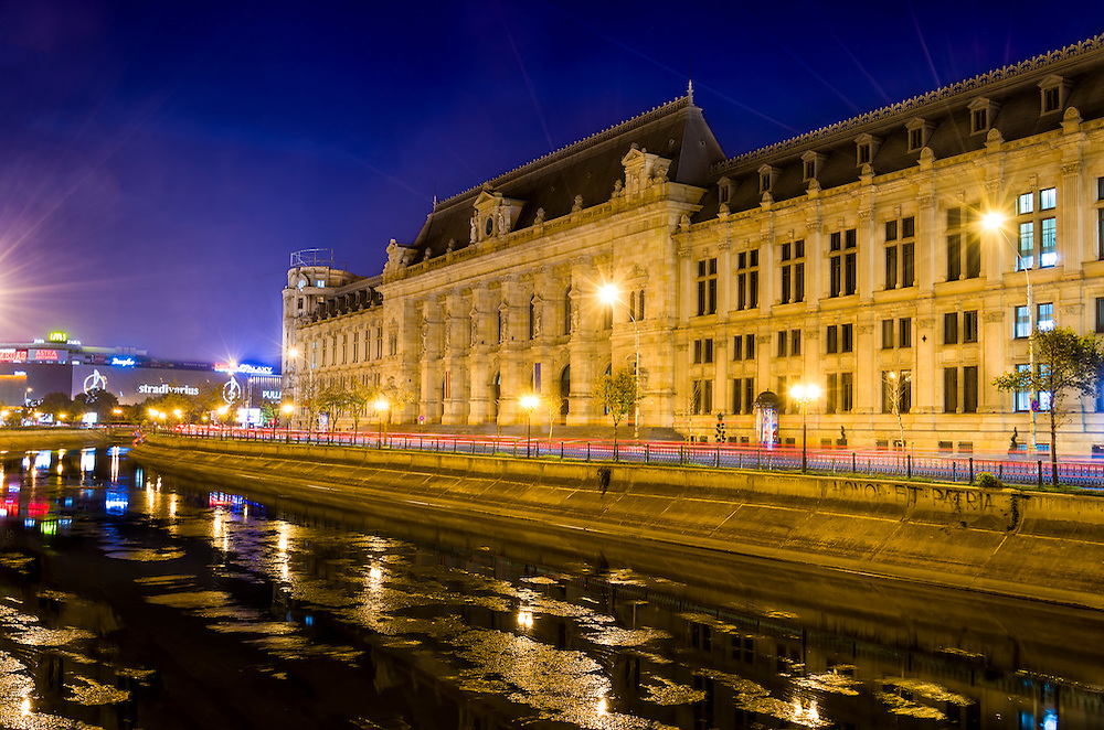 BUCHAREST, ROMANIA - OCTOBER 1 2012: Night view of The Palace of Justice ((Romanian: Palatul Justi?iei) located on the banks of the Dâmbovi?a River in downtown Bucharest, it houses the Bucharest Court of Appeal and was originally built between 1890 and 1895.