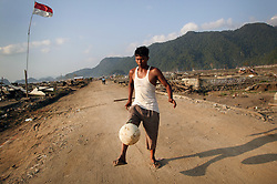 Despite the wreckage and the mental anguish some people still manage to find the enegy to kick a ball, perhaps it helps? Leupung