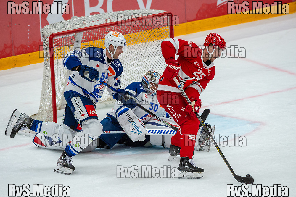 LAUSANNE, SWITZERLAND - OCTOBER 01: Cory Emmerton #25 of Lausanne HC scores a goal against Goalie Lukas Flueler #30 of ZSC Lions during the Swiss National League game between Lausanne HC and ZSC Lions at Vaudoise Arena on October 1, 2021 in Lausanne, Switzerland. (Photo by Robert Hradil/RvS.Media)