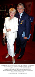 TV presenter GLORIA HUNNIFORD and her husband STEPHEN WAY at a reception in London on 18th March 2003.PIC 29