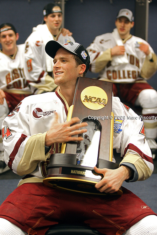 SHOT 4/12/08 8:09:33 PM - Boston College team captain Mike Brennan (center, holding trophy) celebrates with teammates in the lockerroom after beating Notre Dame 4-1 in the NCAA Frozen Four championship game at the Pepsi Center in Denver, Co. Boston College won the game 4-1 to win the national championship..(Photo by Marc Piscotty / © 2008)