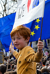 A boy and his banner await the start of the rally in Parliament Square as organisers claim up to a million people from across the UK are marching from Park Lane to Parliament demanding a People's Vote on the EU withdrawal agreement before the UK leaves the EU. London, March 23 2019